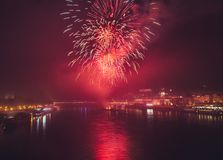 Fireworks over the river in the city Stock Photography