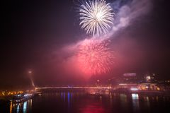 Fireworks over the River in the City Royalty Free Stock Photo