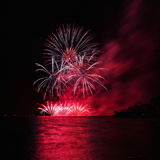Fireworks over the river. Stock Image