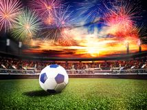 Fireworks over soccer stadium as final win game. Fireworks over soccer football stadium as world cub championship final game win concept background, mixed media stock image