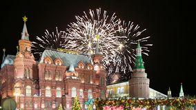 Fireworks over the State Historical Museum inscription in Russian, near the Kremlin in Moscow, Russia stock video