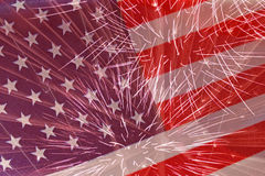 Fireworks over United States flag Stock Photos