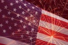 Fireworks over United States flag Stock Photos