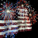 Fireworks over US Flag 1. Fireworks displayed over the American Flag against a night sky Royalty Free Stock Images