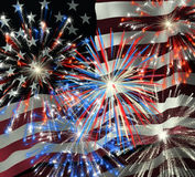 Fireworks over US Flag 2. Fireworks displayed over the American Flag Royalty Free Stock Image