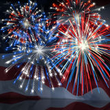 Fireworks over US Flag 3. Fireworks displayed over the American Flag Royalty Free Stock Photography
