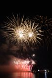 Fireworks over the water 1. Festival fireworks in Kiev on the Dnieper River Royalty Free Stock Photo