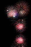 Fireworks over Water. Firework display at night with water reflection Royalty Free Stock Image