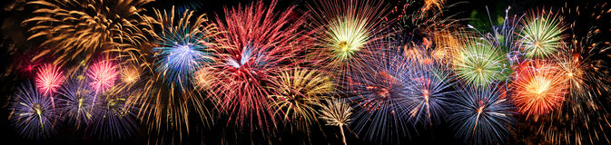 Fireworks in Panoramic View. Colorful panoramic view of fireworks over night sky royalty free stock photography