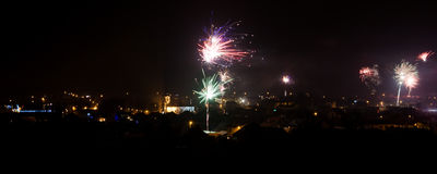 Fireworks panoramic view. Panorama of small city New Years Eve Fireworks Stock Image
