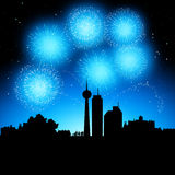 Fireworks Party. Fireworks coming to life over a city at night Stock Images