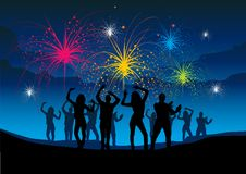 Fireworks Party. A group of people enjoying a night of celebration Stock Images