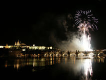 Fireworks in Prague. Above Charles bridge with Prague castle in the background Royalty Free Stock Photography
