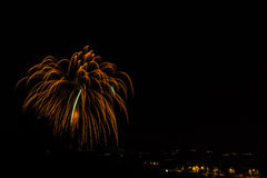 Fireworks. Pyrotechnical show with light and colors on black sky Royalty Free Stock Images