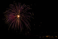 Fireworks. Pyrotechnical show with light and colors on black sky Royalty Free Stock Photography