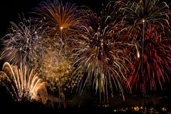 Fireworks. Pyrotechnical show with light and colors on black sky Royalty Free Stock Image