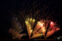 Fireworks pyrotechnics in the sky. Fireworks pyrotechnics during an anniversary airshow. Countdown begins royalty free stock image
