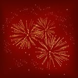 Fireworks on a red background. Yellow fireworks on a red dark background Stock Photos