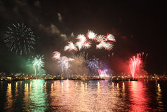 Fireworks reflect on sea water Stock Images