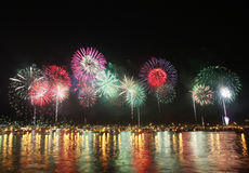 Fireworks reflect on sea water Royalty Free Stock Photography