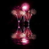 Fireworks reflect water for festival Stock Photo