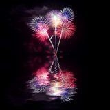 Fireworks reflect water for festival Royalty Free Stock Photography