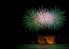 Fireworks reflecting in the water during Forte dei Marmi Interna Stock Photo