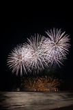 Fireworks reflecting in the water from Forte dei Marmi's Pier Stock Photos