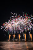 Fireworks reflecting in the water from Forte dei Marmi's Pier Royalty Free Stock Photos