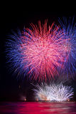Fireworks reflecting in the water from Forte dei Marmi's Pier Royalty Free Stock Photo
