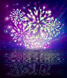 Fireworks and reflection. New Year's fireworks over water at night Royalty Free Stock Photos