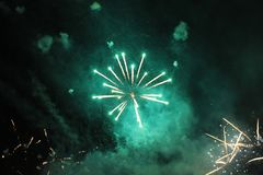 Fireworks. Salute. Sky background Amazing agony of bright yellow and green twinkling lights in the night sky during the New Year stock images