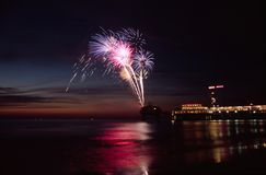Fireworks at sea. Fireworks at the beach during sunset stock images