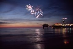 Fireworks at sea. Fireworks at the beach during sunset royalty free stock photography
