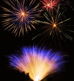 Fireworks show. Aerial fireworks display and ground display Royalty Free Stock Images