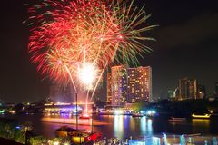 Fireworks show in Celebrate on festival day at Chao Phraya River at night time, Bangkok, Thailand. Beautiful of light. stock photo