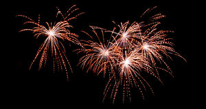 Fireworks show. Colorful fireworks on the dark night sky Stock Photos