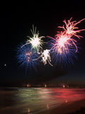 Fireworks show reflecting in the water from Forte dei Marmi's Pi Stock Image
