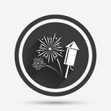 Fireworks sign icon. Explosive pyrotechnic show. Fireworks with rocket sign icon. Explosive pyrotechnic symbol. Circle flat button with shadow and border Stock Photos