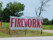 Fireworks Sign Near County Line. This fireworks sign sits outside a roadside fireworks stand near a county line where fireworks cannot be sold Stock Images