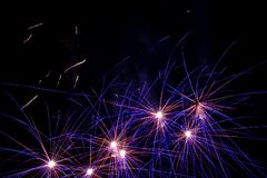 Fireworks in the sky. Blue and yellow lights in the shape of a star stock images