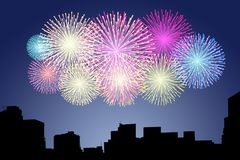 Fireworks on the sky in city. Celebration happy new year Royalty Free Stock Photography