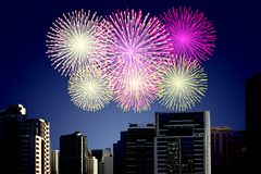 Fireworks on the sky in city. Celebration happy new year Royalty Free Stock Photo
