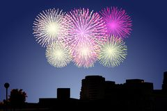 Fireworks on the sky in city. Celebration happy new year Royalty Free Stock Image