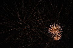Fireworks on a sky full of stars Stock Photography