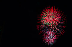 Fireworks in the sky. Fireworks on the right hand side with empty copy space on the left Stock Image
