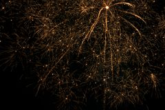 Golden Fireworks in the sky stock images