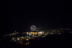 Fireworks in a small city at night Royalty Free Stock Image