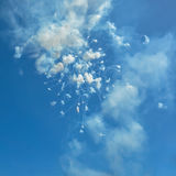 Fireworks and smoke in the blue sky in day time Ischia Italy. Blue sky with fireworks firecrackers and smoke in day time Ischia Italy Royalty Free Stock Image