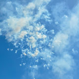 Fireworks and smoke in the blue sky in day time Ischia Italy. Blue sky with fireworks firecrackers and smoke in day time Ischia Italy Stock Photos